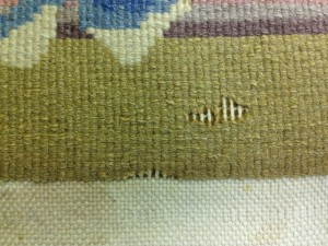 Moth Damage On The Back Of A Chinese Rug